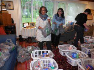 Volunteers standing in front of baskets of goods (Courtesy of Uzma Farooq)