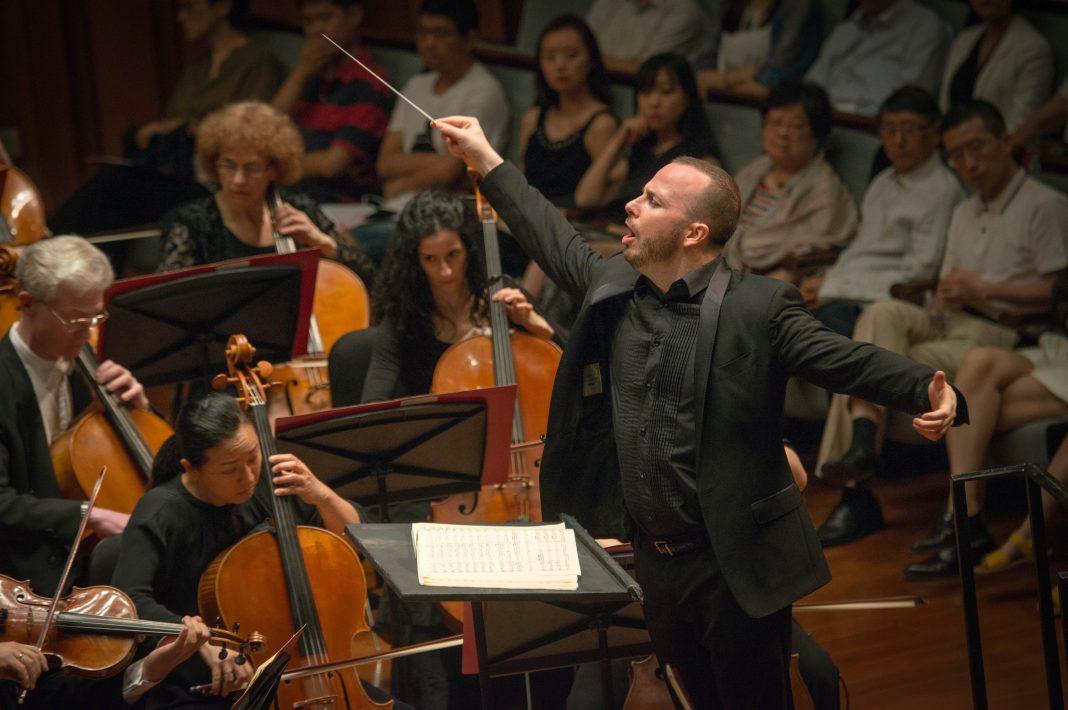 Man conducting an orchestra (Jan Regan/Philadelphia Orchestra)