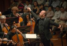 Man conducting an orchestra (Jan Regan/Philadelphia Orchestra)