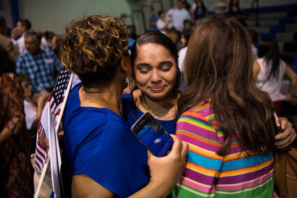 Three women embracing (© Carolyn Van Houten/The Washington Post/Getty Images)