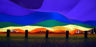 Giant rainbow flag billowing (© Getty Images/Nur Photos)