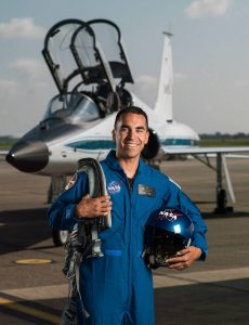 Raja Chari in flight suit and in front of jet (NASA)