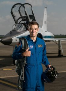 Robb Kulin in flight suit and in front of jet (NASA)