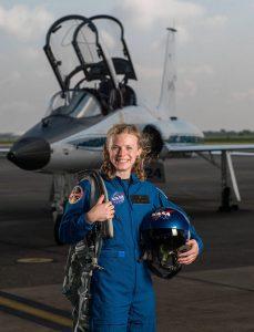 Zena Cardman in flight suit and in front of jet (NASA)