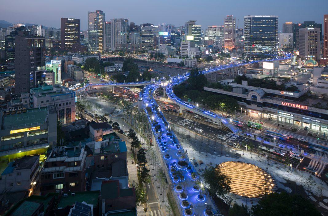 Overhead view of city with blue-lighted walkways (© MVRDV/Ossip van Duivenbode)
