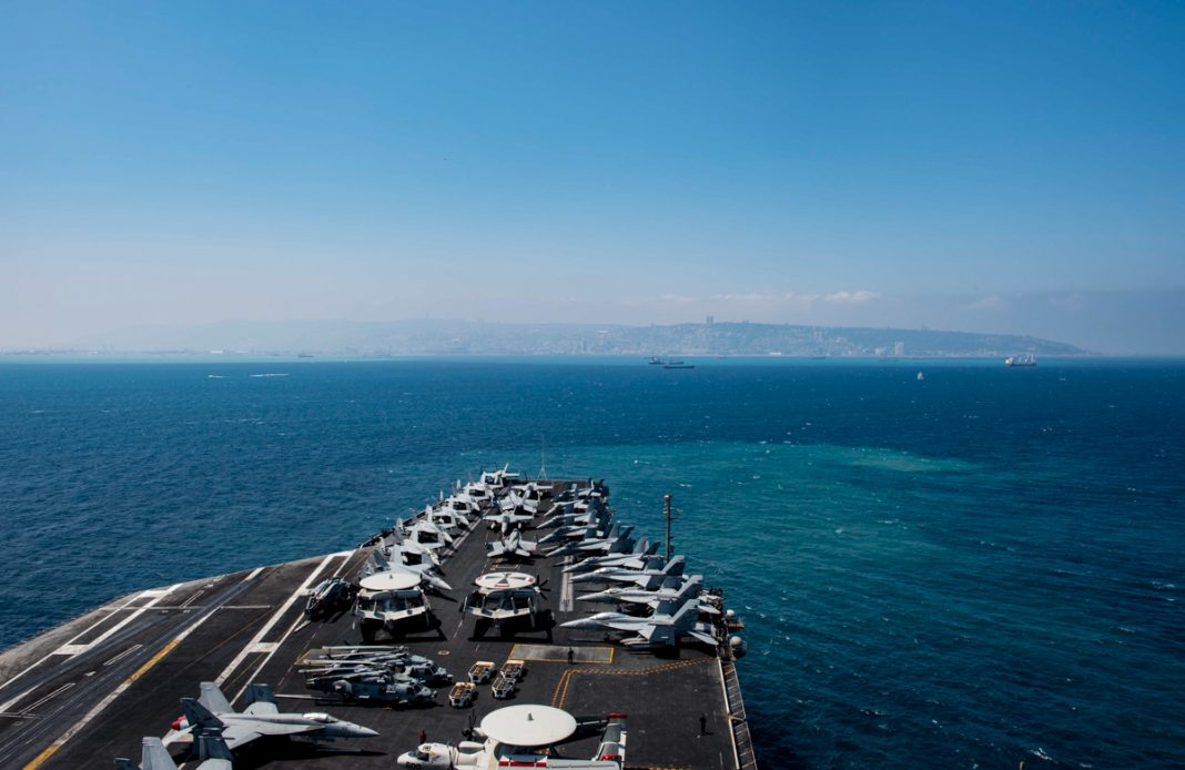 Ship's deck carrying aircraft at sea (DOD/U.S. Navy Petty Officer 2nd Class Michael B. Zingaro)