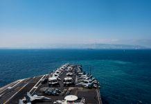 Ship's deck carrying aircraft at sea (DOD/U.S. Navy Petty Officer 2nd Class Michael B. Zingaro)