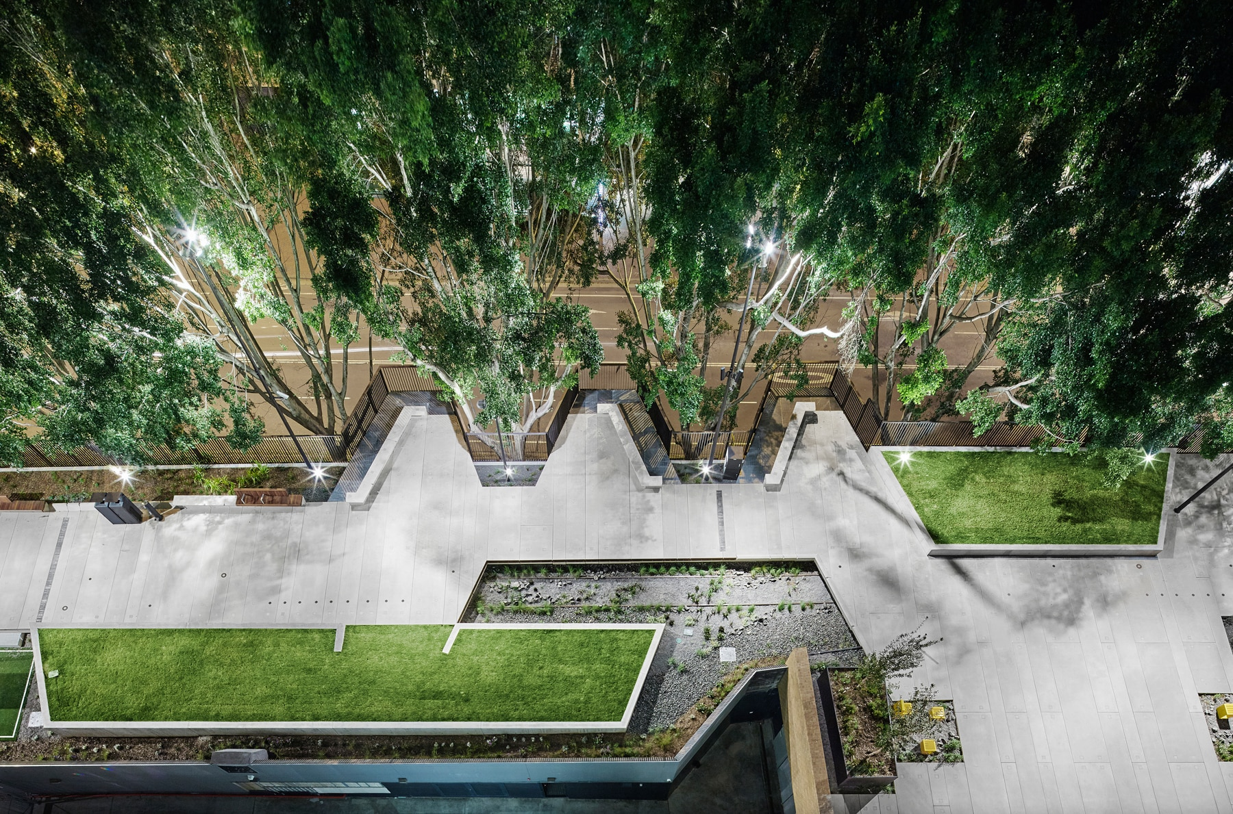 Overhead view of paved pathway surrounded by trees and greenery (ASPECT Studios/Florian Groehn)