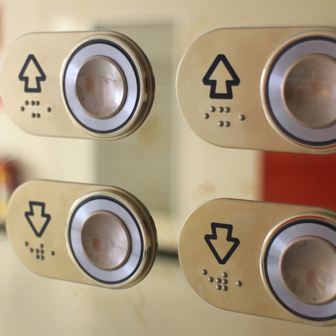 Elevator up and down buttons in braille (© Lee Peiming/Shutterstock)