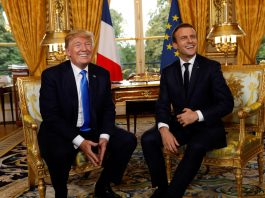 President Trump and French President Emmanuel Macron, seated (© AP Images)