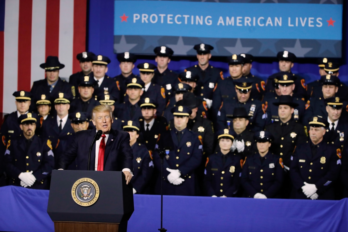 President Trump at lectern in front of large number of law enforcement officers in uniform (© AP Images)