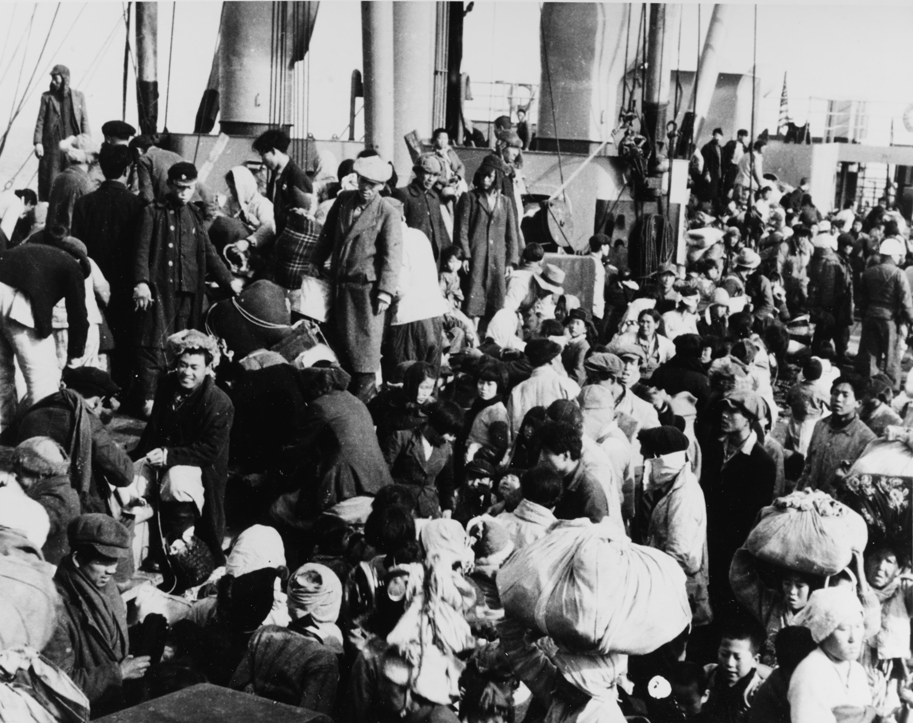 Refugees boarding a ship (U.S. Navy)