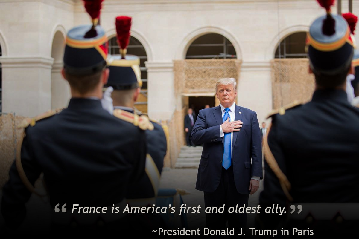 President Trump standing with French soldiers (© AP Images)
