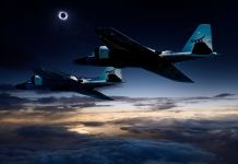 Two jets flying in a dark sky (NASA)