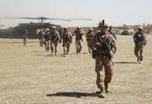 Soldiers walking away from a helicopter (Sgt. Lucas Hopkins/USMC)