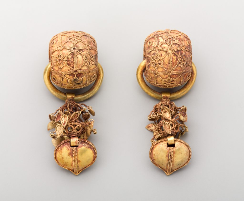 Pair of elaborate gold earrings (© Sarah DeSantis, Brooklyn Museum)