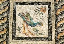 Floor mosaic tile showing figure of bird (© Ariadne Van Zandbergen/Alamy)