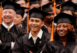 Students wearing graduation gowns and mortar boards (© AP Images)