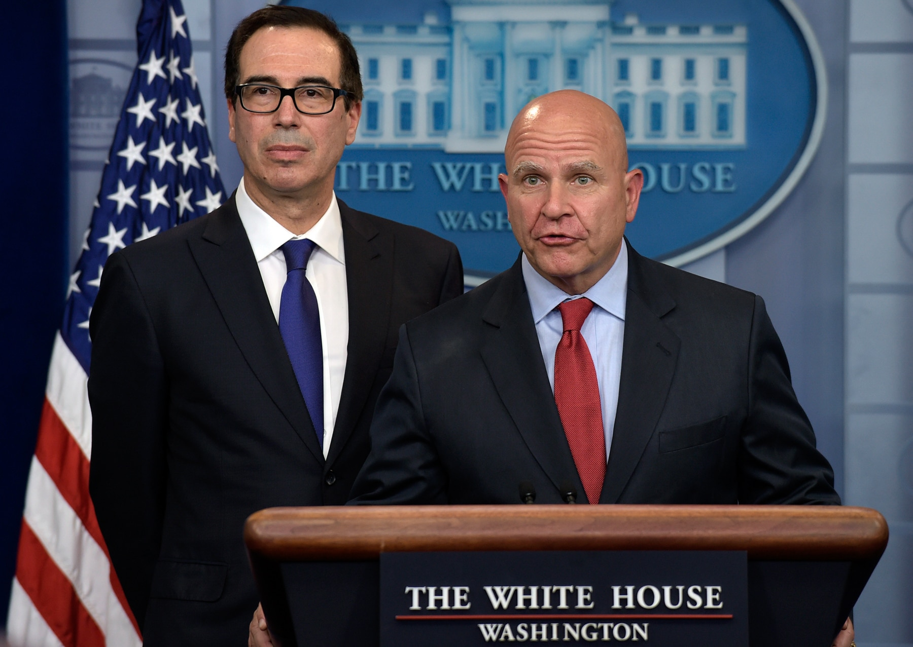 Two men standing behind lectern (© AP Images)