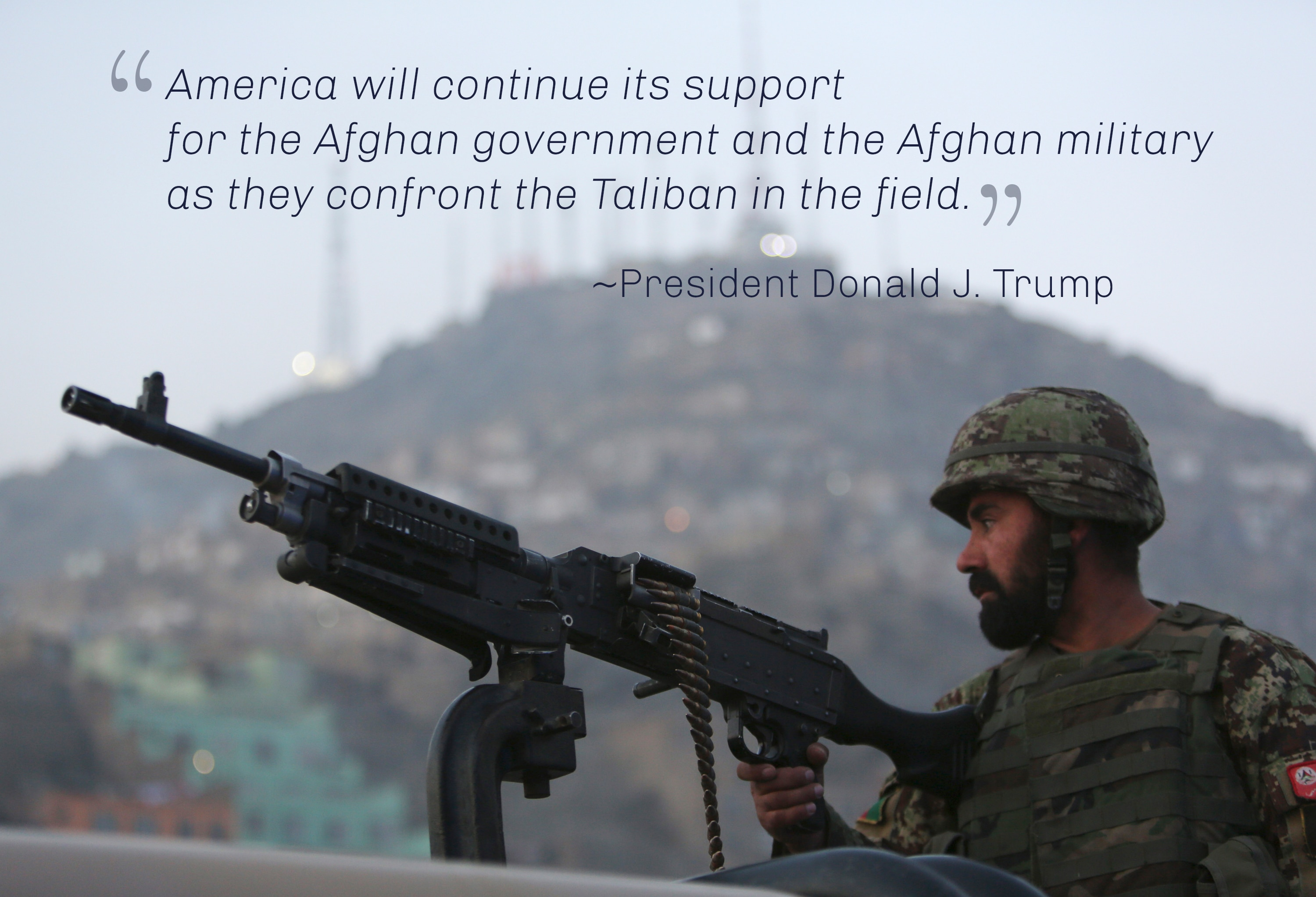 Man in uniform with gun with words by President Trump expressing U.S. support for Afghan government and military (© AP Images)