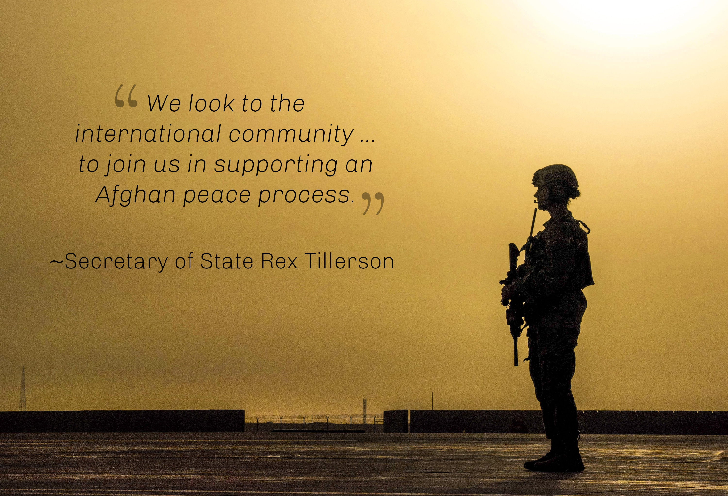 Silhouette of soldier and wall with Secretary Tillerson's words on international support for an Afghan peace process (U.S. Air Force)