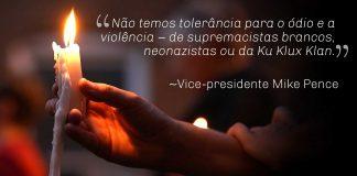 Mão segura bandeira e citação do vice-presidente Pence (Depto. de Estado)