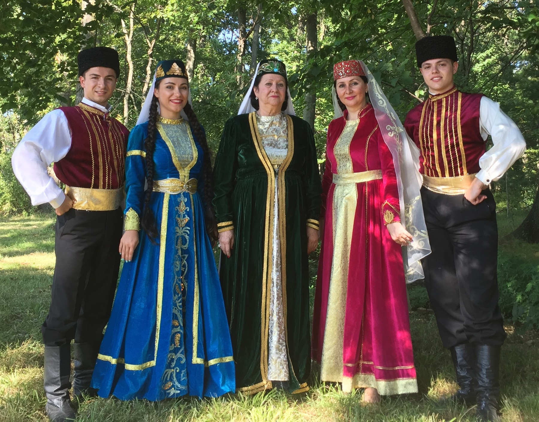 Five people in colorful, embroidered outfits (Efsane Crimean Tatar Ensemble)