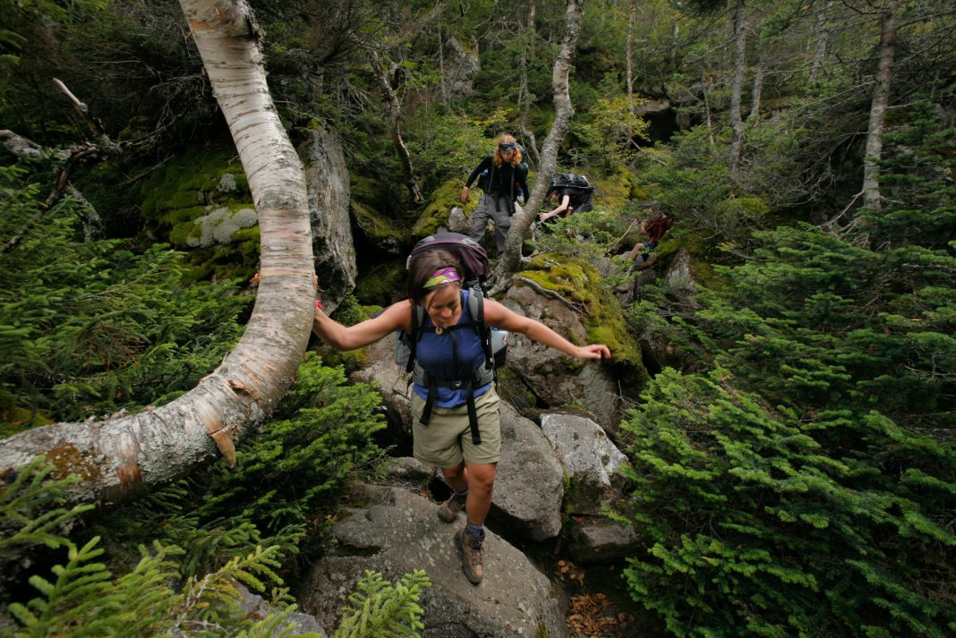Hikers crossing over rocks on Appalachian Trail (© Gregory Rec/Portland Press Herald via Getty Images)