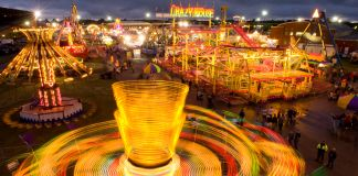 Blurred lights from spinning carnival rides (© Joel Sartore/National Geographic)