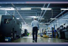Man walking through factory (State Dept.)