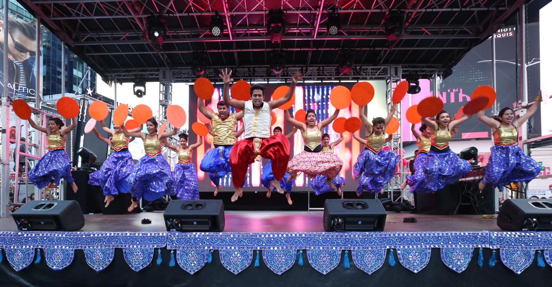 Indian dancers performing on a stage (Diwali at Times Square)