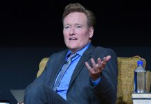 Conan O'Brien in chair (© AP Images)