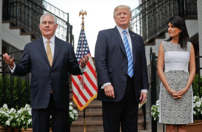 Rex Tillerson, President Trump and Nikki Haley standing together (© AP Images)