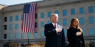 Donald Trump and Melania Trump placing hands over hearts in front of the Pentagon (© AP Images)