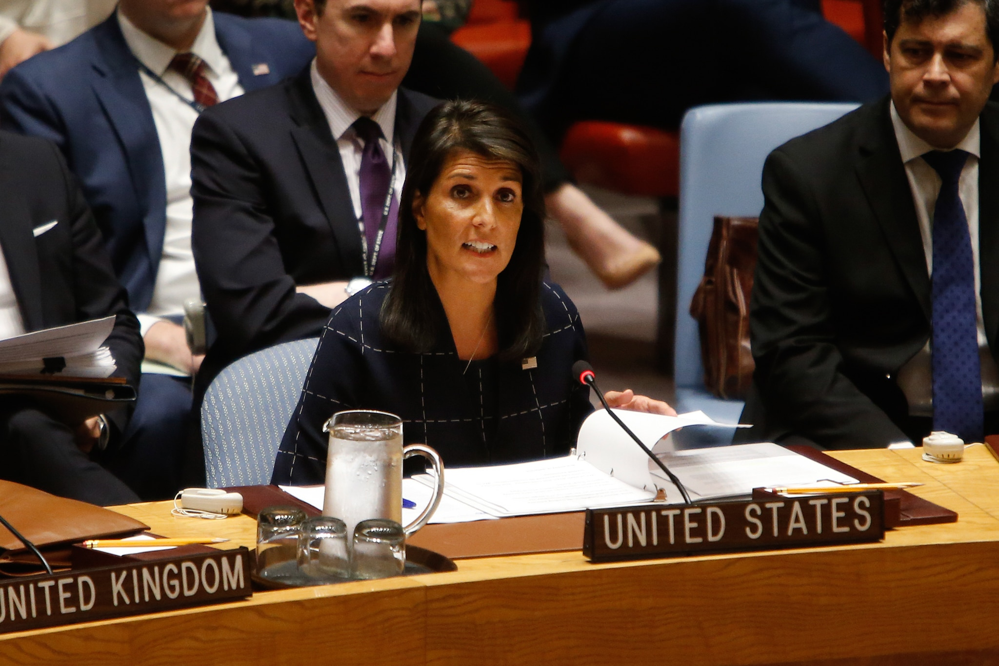 Nikki Haley seated at desk with microphone (© AP Images)
