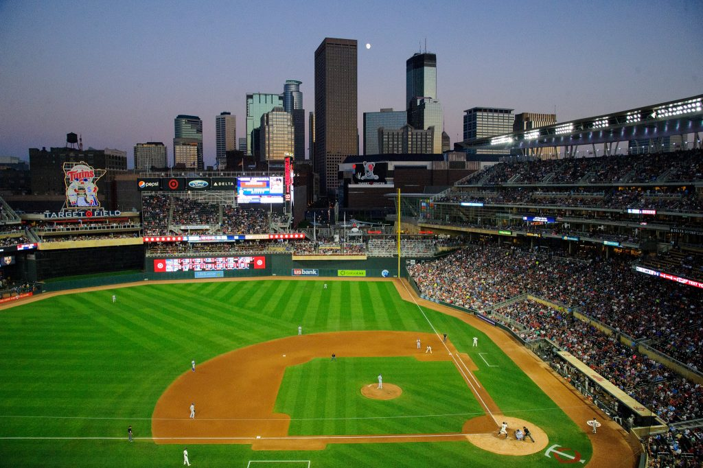 Aerial view of baseball stadium with skyline in background (© Hannah Foslien/Getty Images)