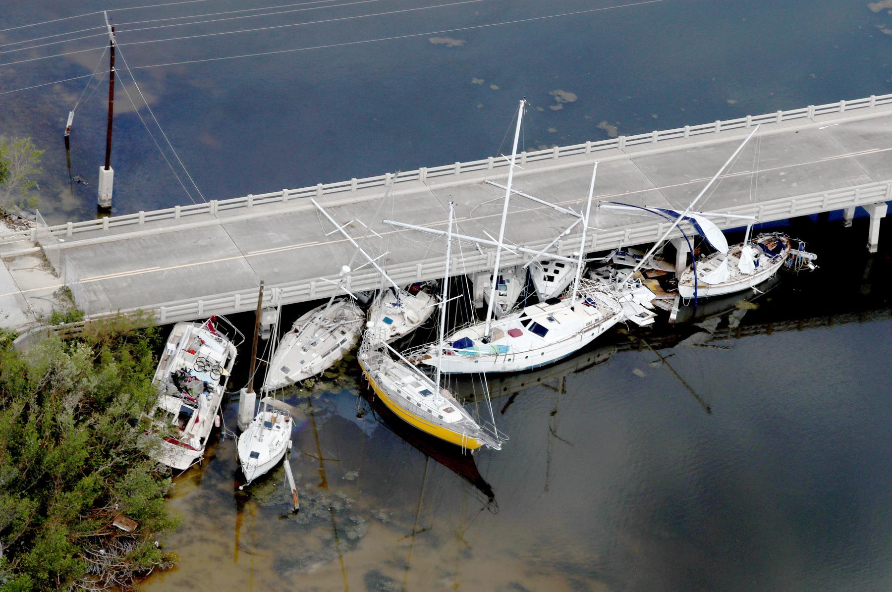 Boats wedged under bridge (© Mike Stocker/Sun-Sentinel/TNS via Getty Images)