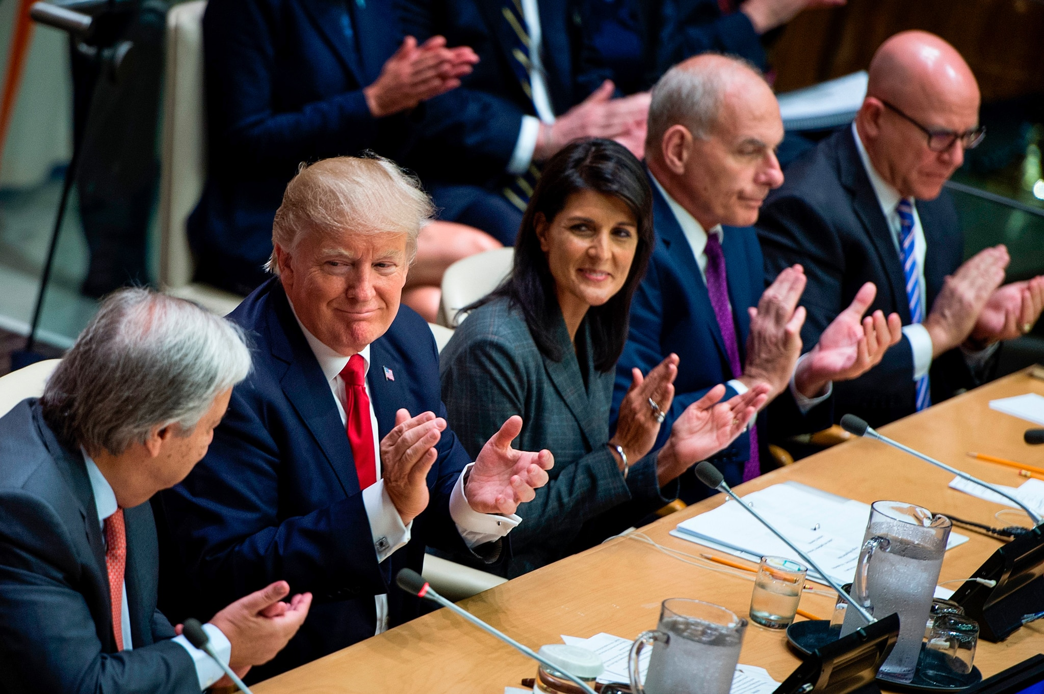 Five people sitting side by side clapping (© Brendan Smialowski/AFP/Getty Images)