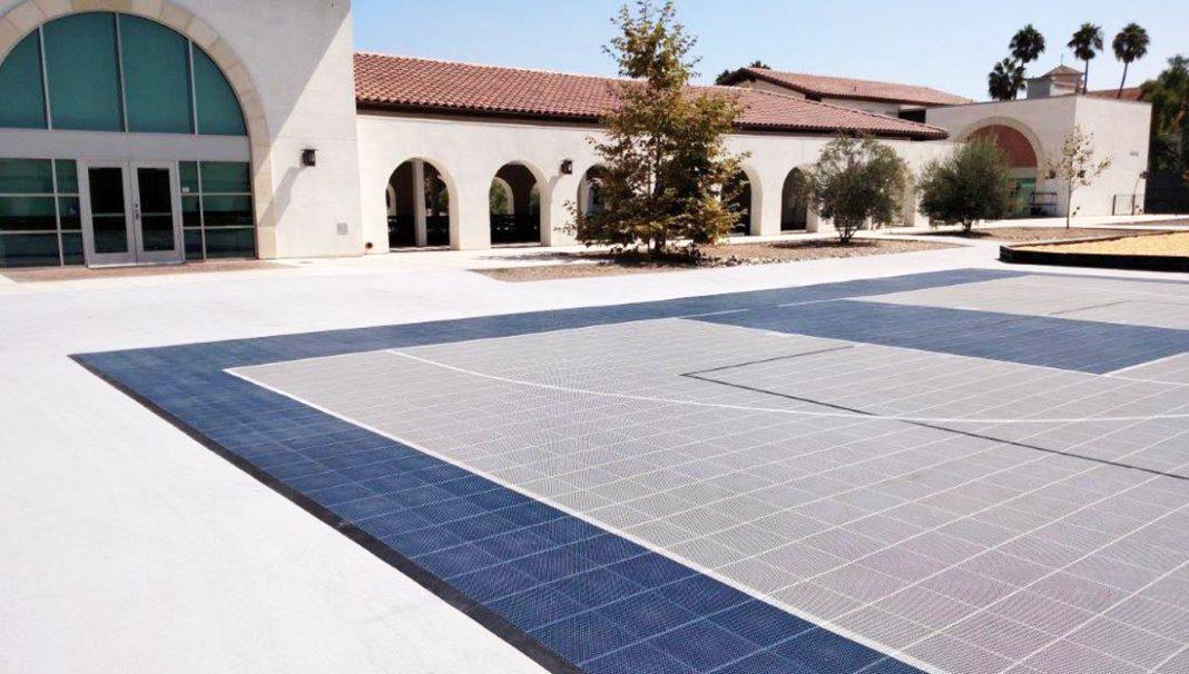 Spanish-style buildings facing basketball court (Guardtop LLC)