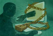 Ilustrasi komputer terbungkus rantai dan tangan yang membentang dari layar (State Dept. / D. Thompson)