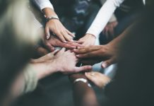 Hands of different races joined together (Shutterstock)