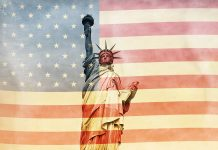 Statue of Liberty superimposed on US flag (© Shutterstock)