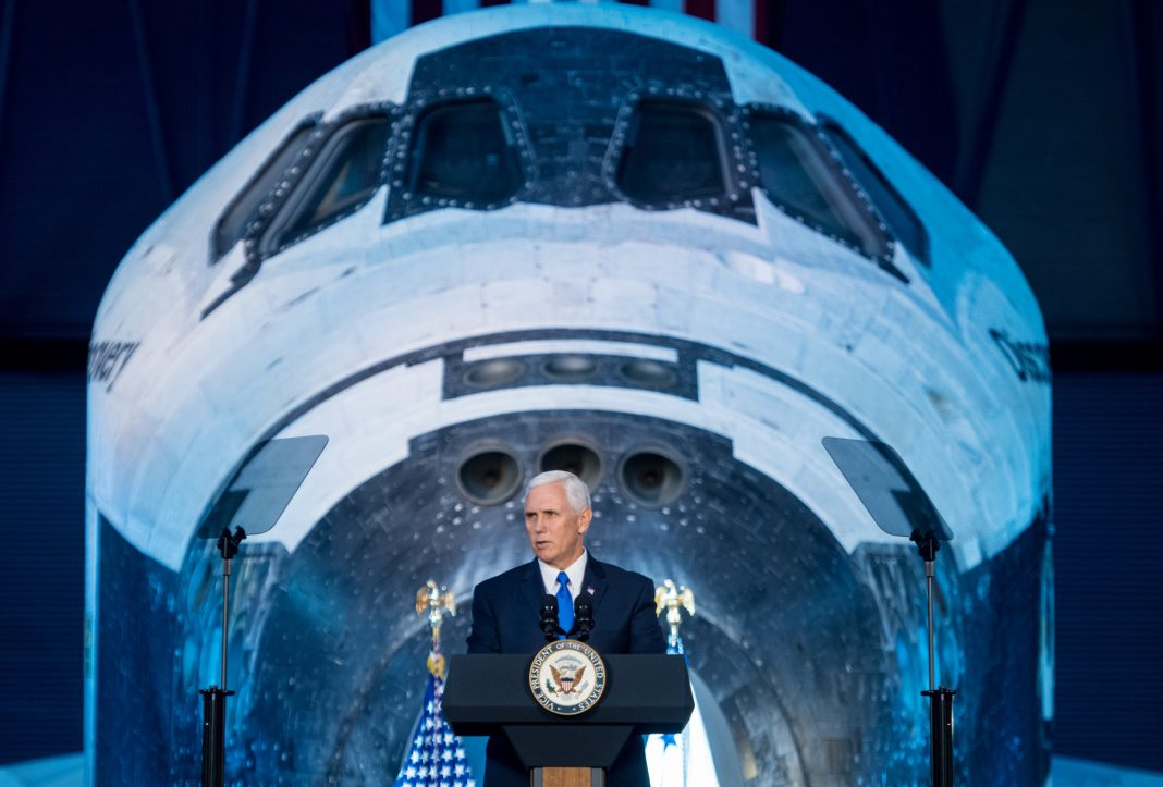 Vice President Pence speaking in front of a space shuttle (NASA)