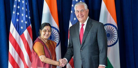 Sushma Swaraj and Rex Tillerson shaking hands (State Dept.)