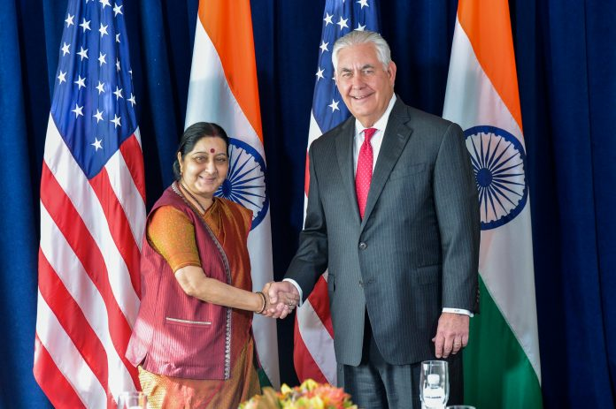 Sushma Swaraj and Rex Tillerson shaking hands (State Dept.)