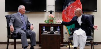 Rex Tillerson and Ashraf Ghani seated and talking (© AP Images)