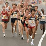 Group of racers on road (© AP Images)