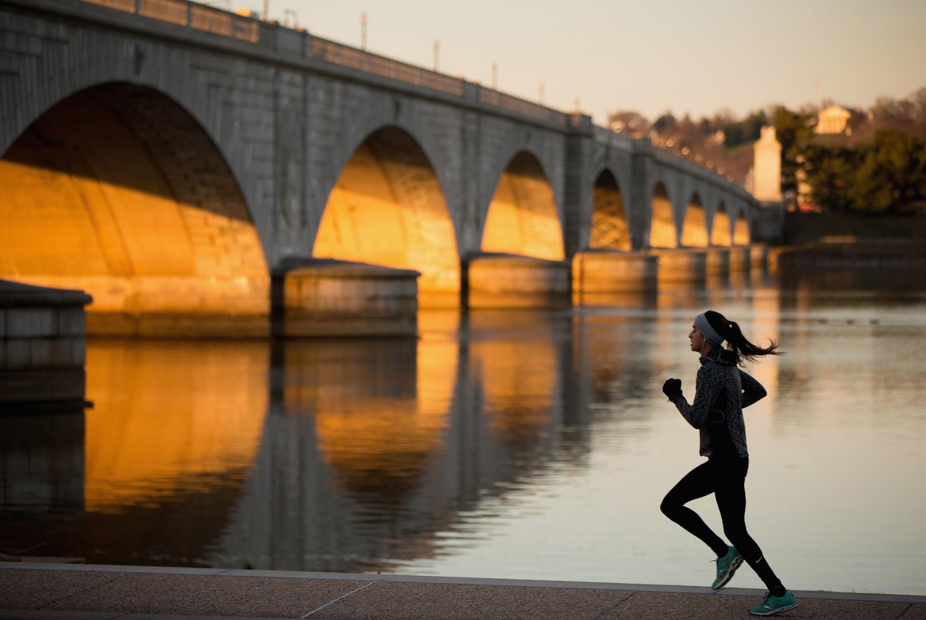 Jogger passing a bridge (© AP Images)