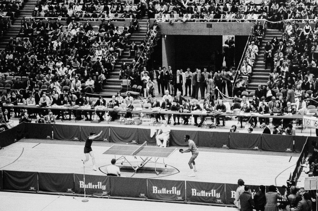 Table tennis game in large stadium filled with spectators (© AP Images)