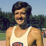 Headshot of Frank Shorter, smiling (© AP Images)
